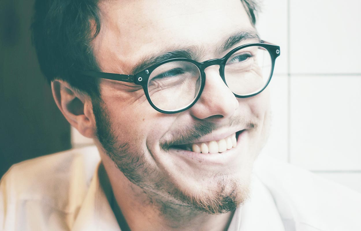 Smiling invisalign man with glasses