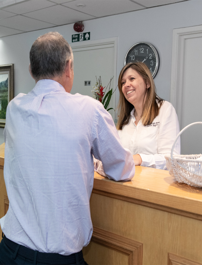 Receptionist greeting new patient
